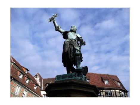 Schwendi  monument moinseur Bartholdi poolt. Schwendil on seos Tokay viinamarjaga, mis nüüd Alsace´s lubatud pole ja tuleb Pinot Gris ´ks nimetada